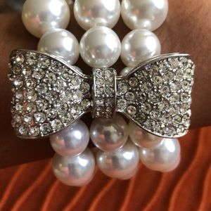 White House Black Market Jewelry - Pearl and diamond bow stretch bracelet